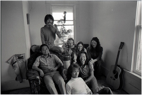 From left: unidentified, Yoshi, Kenneth Fletcher, Annastacia McDonald, Charles Rea, Paul Wong, unidentified, with pot plant and Mr. Fischer, 4196 Main Street, c. 1976, Courtesy of Kazumi Tanaka