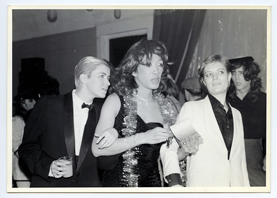 Paul Wong and escorts at the fifth annual Drag Ball held at the NDP Hall, 4603 ½ Main Street, December 19, 1980, Courtesy of Mary Janeway