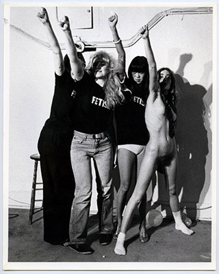 The S.S. Girls with fists raised: Jeanette Reinhardt, Carol Hackett, Deborah Fong, Annastacia McDonald, High Profile Slow Scan performance, Video Inn, Vancouver and CN Tower, Toronto, October 13, 1978, Courtesy of Paul Wong