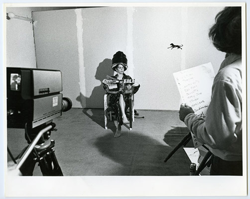 Robert Hackett reading File Magazine and unidentified participant with scene listing, High Profile Slow Scan performance, Video Inn, Vancouver and CN Tower, Toronto, October 13, 1978, Courtesy of Paul Wong