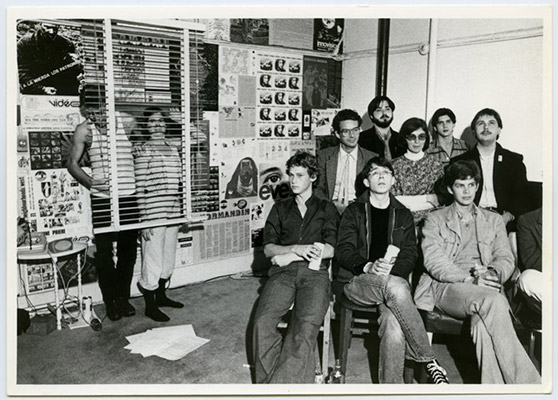 Standing: Hank Bull, Kate Craig. Audience seated from back to front: Sid Morozoff, unidentified, Warren Knetchel, Rosemary Brown, Danny Kostyshin, unidentified, Roy Arden, Dave Enblom, High Profile Slow Scan performance, Video Inn, October 13, 1978, Courtesy of Paul Wong