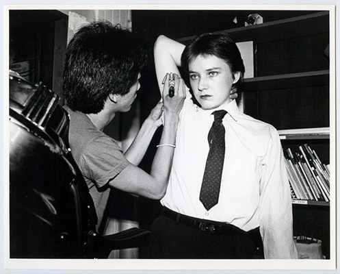 "Paul Wong drawing ""SS"" on Jeanette Reinhardt, High Profile Slow Scan, Video Inn, Vancouver and CN Tower, Toronto, October 13, 1978, Courtesy of Paul Wong"