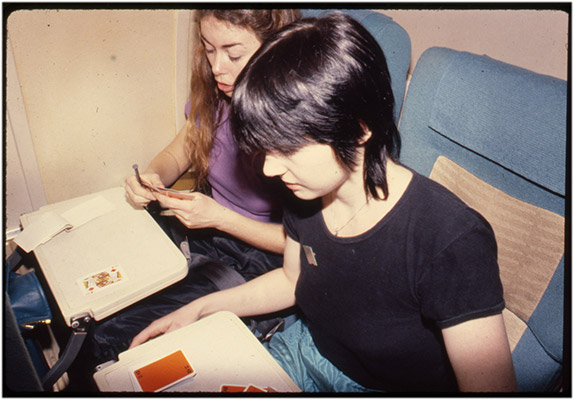 Annastacia McDonald and Jeanette Reinhardt playing cards during a flight, tour de '4', 1980, Courtesy of Paul Wong
